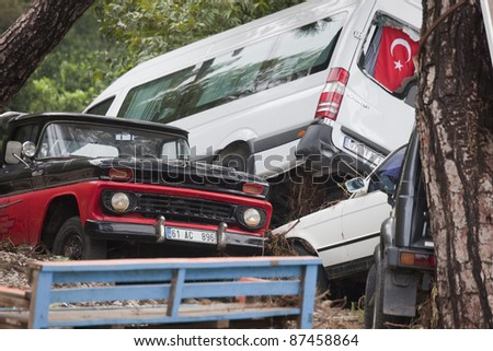 OLYMPOS, TURKEY - OCTOBER 14: Crashed cars in the woods after flood disaster on October 14, 2009 in Olympos, Turkey, Asia. The floods destroy roads and houses and swept away about 50 cars.