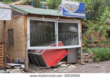 OLYMPOS, TURKEY - OCTOBER 14: Destroyed Fast Food Restaurant with overturned Counter after flood disaster on October 14, 2009 in Olympos, Turkey. The floods destroyed roads and houses.
