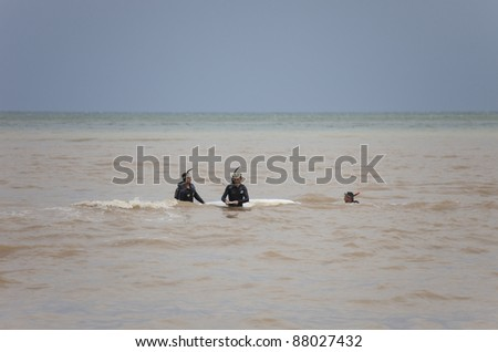 OLYMPOS, TURKEY - OCTOBER 14: Frogmen doing rescue work after flood disaster on October 14, 2009 in Olympos, Turkey. The floods swept away about 50 cars and motorcycles from the road into the sea.