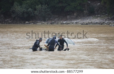 OLYMPOS, TURKEY - OCTOBER 14: Frogmen doing rescue work after flood disaster on October 14, 2009 in Olympos, Turkey, Asia. The floods swept away about 50 cars and motor bikes.
