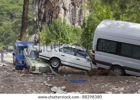 OLYMPOS, TURKEY - OCTOBER 14: Wedged cars in the woods after flood disaster on October 14, 2009 in Olympos, Turkey, Asia. The floods  destroy  roads and houses and swept away about 50 cars.
