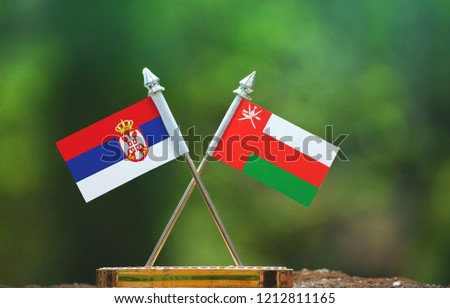 Oman and Serbia small flag with blur green background #1212811165