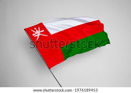 Oman flag isolated on white background with clipping path. close up waving flag of Oman. flag symbols of Oman. Oman flag frame with empty space for your text.