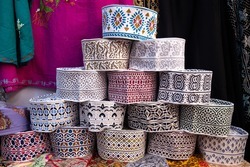 Omani hat called kumma. Traditionally embroidered in different patterns and colours. Sold at the local market. Muttrah souq outside of Muscat in Oman