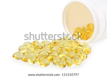 omega 3 capsules and container on white
