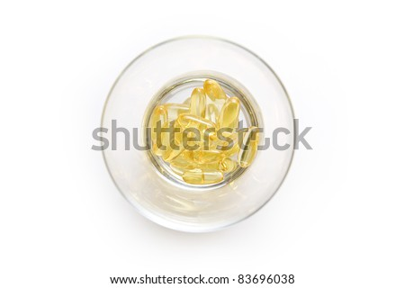 Omega 3 gel capsules in a glass, Capsules of fish oil gel. (top view) - stock photo