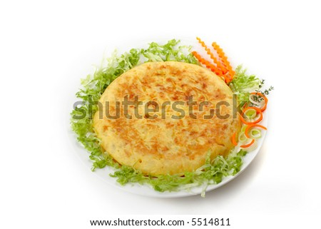 Omelet served on a plate with vegetables