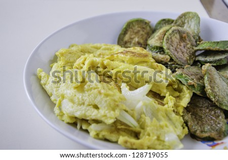 Omelet with fried eggplants vegetables - stock photo