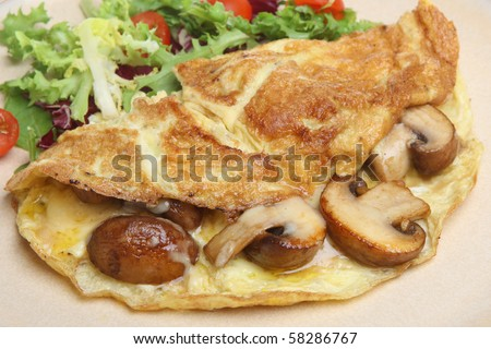 Omelet with sauteed mushrooms and cheese. - stock photo