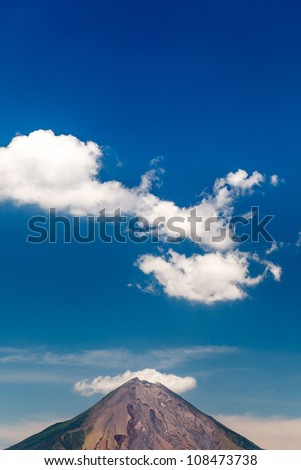 OMETEPE ISLAND, NICARAGUA: Peak of volcano Conception and clouds in a blue sky