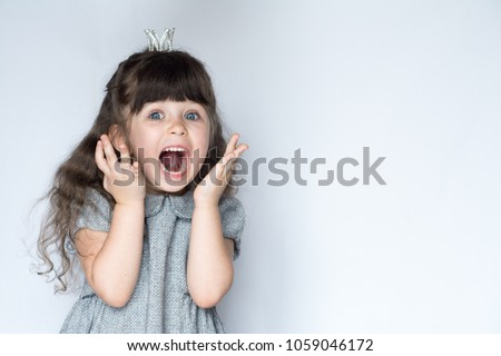 OMG! No! Portrait of 4-5 years old girl, screaming with open mouth and crazy expression. Surprised or shocked face. Free space for advertisement.