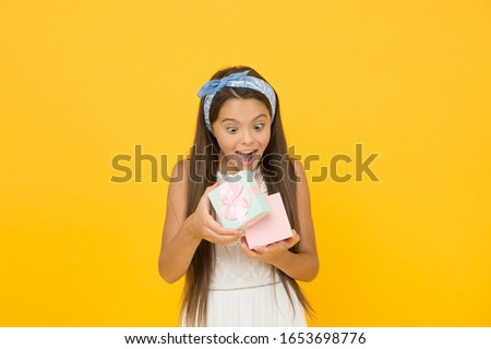 OMG. Surprised child open box yellow background. Little girl got surprise gift. Birthday surprise. Special surprise. Present shop for kids. Gift wrapping. Enjoying surprise.