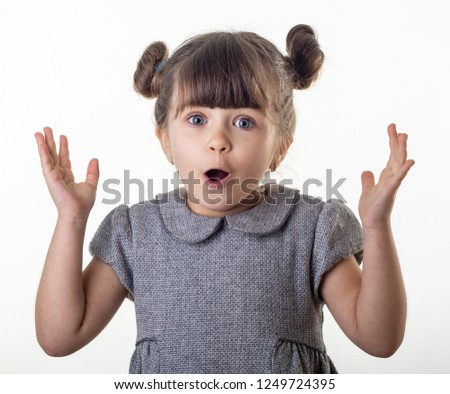 OMG! Wow! Happy surprised child 4 or 5 years old isolated on white. Shocked face little kid on white background. Young girl open mouth, big eyes and crazy expression