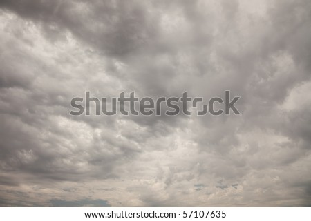 Ominous Dark Cloudy Stormy Sky Background Image.