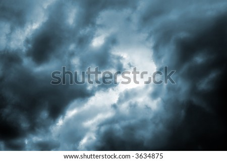Ominous dark thunderstorm clouds in the sky(cyan toned version)
