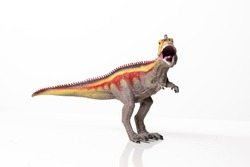 Ominous T-Rex dinosaur figurine isolated against a clean white background. Monstrous animal with sharp teeth