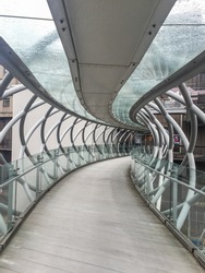 Omni Bridge is criss-crossing steel and glass bridge stretching over Leith Street in Edinburgh, Scotland.