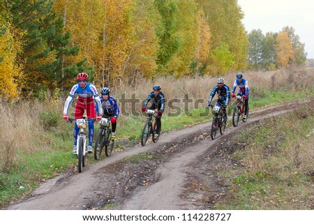 OMSK, RUSSIA - SEPTEMBER 29: Unidentified cyclists take part in the mountain bike cross-country marathon   in the city of Omsk, September 29, 2012