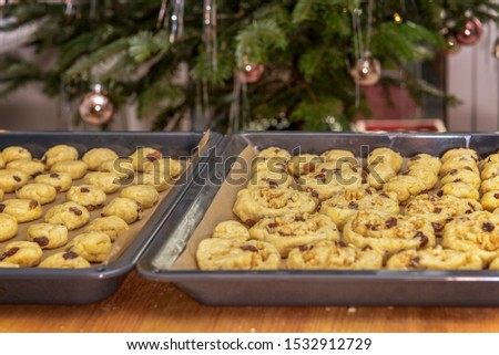 On a baking sheet is not ready-baked Stollen confectionery. Concept: Christmas and baking