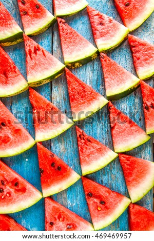 on a blue background flat triangles of watermelon/ - Shutterstock ID 469469957