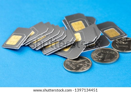 on a blue background in a pile piled money and SIM cards for the phone, Russian rubles