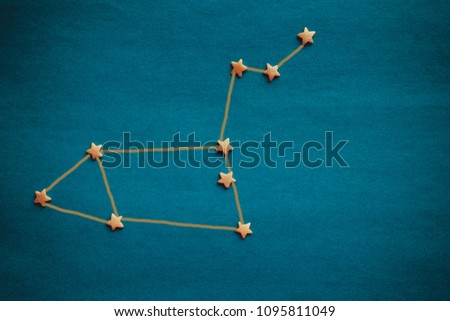 On a blue background, the schematic arrangement of the stars, the constellation Leo. Horoscope, the influence of stars on fate. The picture is made by the author, vignetting.