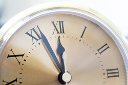 on a clock with Roman numerals from five to twelve. new year new day new life concept. copy space