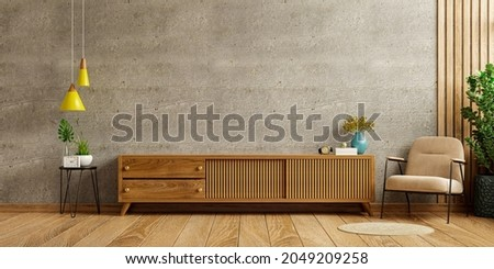 On a concrete wall background, a cabinet TV in a modern living room with an armchair and a plant.3D rendering