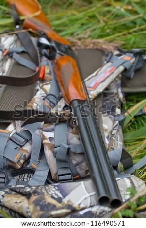 on a halt, hunting gun and backpack