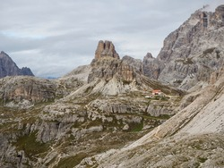 On a hike to a deserted lodge high up among the beautiful mountain peaks of the Italian Dolomites on a wonderful summer day