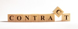 On a light background on wooden cubes the word CONTRACT is written. Business concept