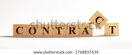 On a light background on wooden cubes the word CONTRACT is written. Business concept Stock foto ©