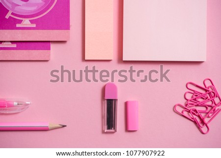On a pink background, school accessories and a pen, colored pencils, a pair of compasses, a pair of compasses, a pair of scissors. Copy space, top view #1077907922