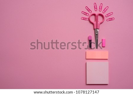 On a pink background, school accessories and a pen, colored pencils, a pair of compasses, a pair of compasses, a pair of scissors. Copy space, top view #1078127147