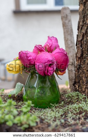 on a rainy day in may in south german historical city view on colorful flowers also in vase #629417861