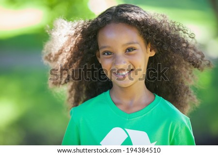 on a sunny Young environmental activist smiling at the camera day - stock photo