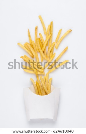 on a white background fried french fries in a white box. studio photo of fried french fries on white background #624610040