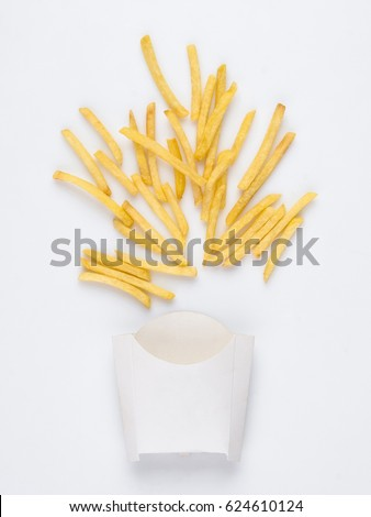 on a white background fried french fries in a white box. studio photo of fried french fries on white background #624610124