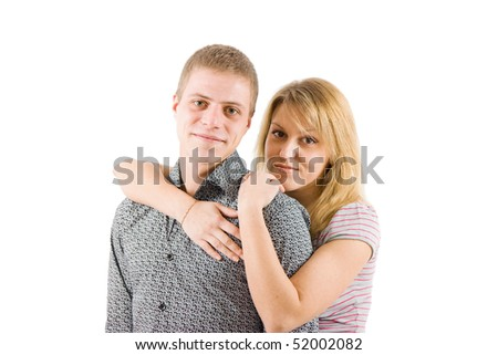 on a white background Young happy couple embracing and smiling