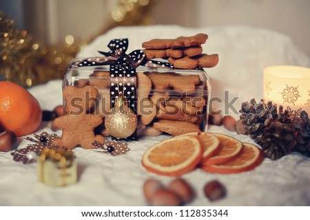 on a white table with a box of cookies and orange segments