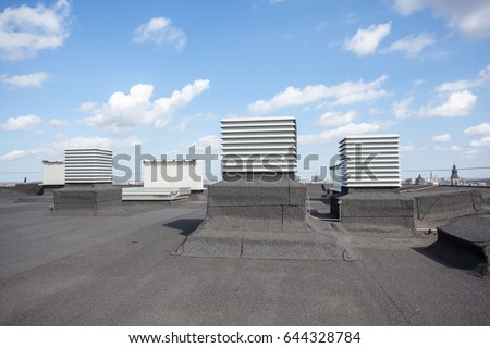 on an flat roof there cooling...