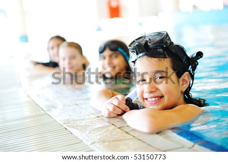 On beautiful pool, summer great time! Girl in row of children