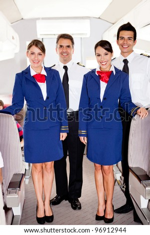 On board friendly team in an airplane smiling
