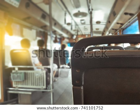 On buses there are passengers sitting.The morning sun shines down on the bus. - Shutterstock ID 741101752