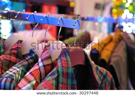 On clothing shop clothes rack's clothes