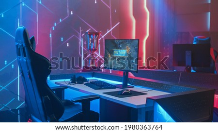 On Cyber Gaming Championship: Empty Gaming Station with Player's Computer Screen Showing Video Game Victory. Online Cyber Gaming Tournament Live Streaming Event