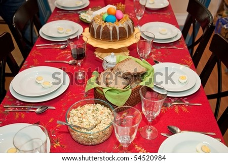 On Easter Sunday morning, beautifully laid table is covered with colored eggs, cold meats, coils of sausages, ham, yeast cakes, pound cakes, poppy-seed cakes, and in the middle of it all