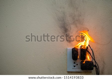 On fire adapter at plug Receptacle on white background, Electric short circuit failure resulting in electricity wire burnt #1514193833