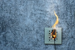 On fire charger adapter on the concrete wall exposed concrete background with space