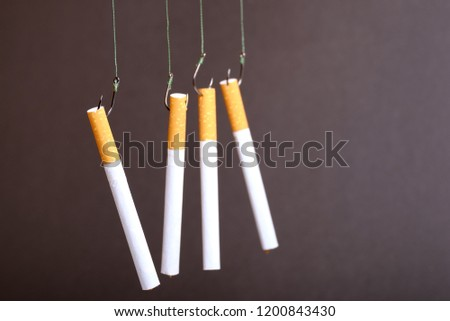 on fishing hooks and thread hung four cigarettes, the danger of falling on the hook depending on the cigarette #1200843430